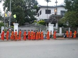 Monks receiving alms through Luang Prabang